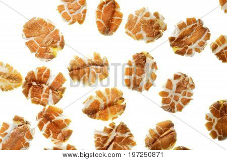 Rye flakes pattern and texture, a close up photo image of rye flakes isolate on white bright light background present a detail of texture and pattern of rye flakes