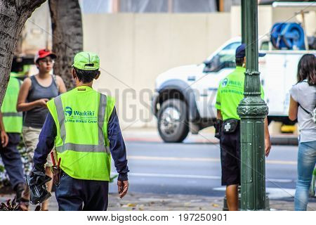 Honolulu Hawaii - May 26 2016: Malama Waikiki Crew members out and about on the street - Waikiki crews provide janitorial maintenance and landscaping services.