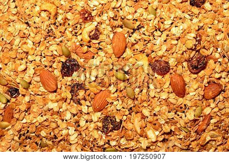 Granola texture, muesli texture, a top view close photo image on granola or muesli pile present a detail in top view of granola or muesli texture a cereal grain healthy food can use for background