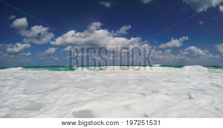 Atlantic ocean with waves and clouds. Nassau, Bahamas.
