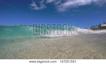 Atlantic Ocean waves during a beautiful day at the beach! Nassau, Bahamas.