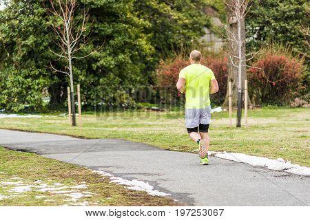 Washington Dc, Usa - March 17, 2017: Man Running On Sidewalk In Spring With Snow On Ground