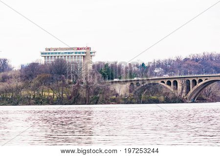 Washington Dc, Usa - March 20, 2017: Closeup Of Potomac River Key Bridge With Marriot Hotel In Arlin