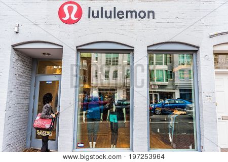 Washington Dc, Usa - March 20, 2017: Lululemon Building Exterior With Woman Entering Store By Sign