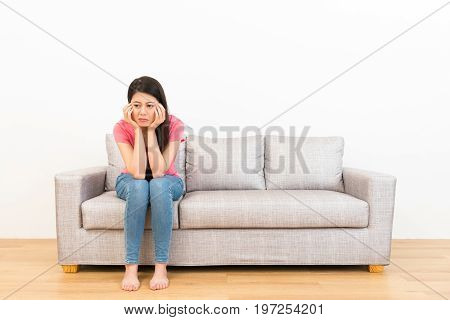 Sad Woman Sitting On The Couch And Weeping Crying