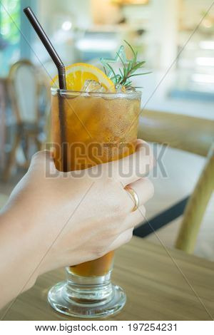 Hand on iced lemon tea stock photo