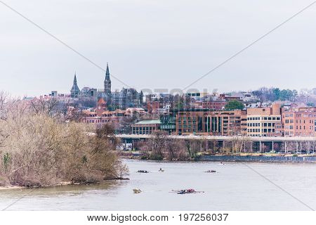 Washington Dc, Usa - March 20, 2017: People Rowing On Potomac River On Many Boats With Skyline Of Ge