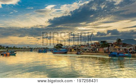 Vietnamese fishing boat's on the cai river used as a harbour with a cloudy sunset sky Nha Trang Vietnam.