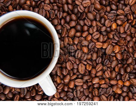 Cup Of Coffee Standing On The Grains