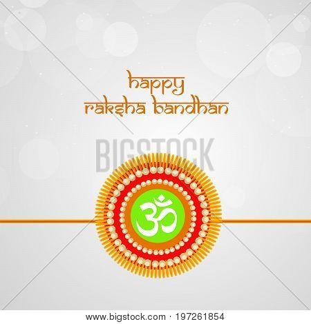 illustration of rakhi and om with happy raksha bandhan text on the occasion of hindu festival Raksha Bandhan