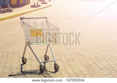 An Emrty Shopping Trolley On Road 01