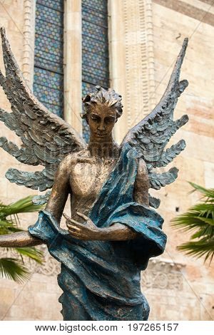 VERONA ITALY - MAY 1 2016: Statue of an angel in front of Duomo in Verona (Cathedral of Santa Maria Matricolare) Verona Veneto Italy