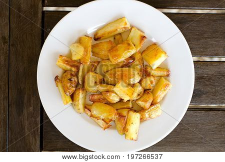 Plate of homemade potato chips from top view