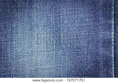 Denim jeans fabric texture background with seam for beauty clothing. fashion business design and industrial construction idea concept.