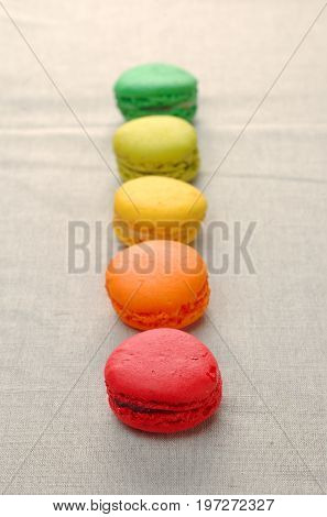 Delicious assortment of colored macaroons with a gradation of color.