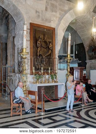 Jerusalem Israel July 14 2017 : Fragment of the interior of the Church of the Holy Sepulchre in Jerusalem Israel. The guide tells visitors about the temple.