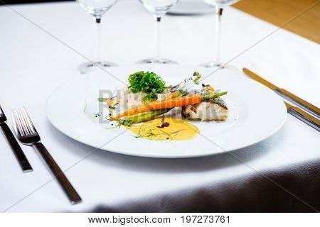 Fillet of cod baked with Paris butter served with sous-vide vegetables and Sauce Hollandaise