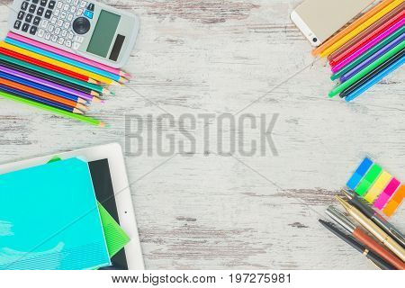 back to school top view frame with school supplies on wooden table