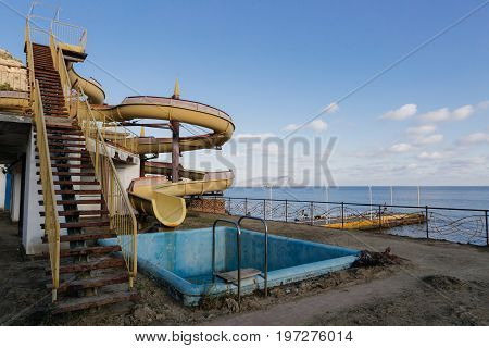 Abandoned water amusement park in Crimea sea shore