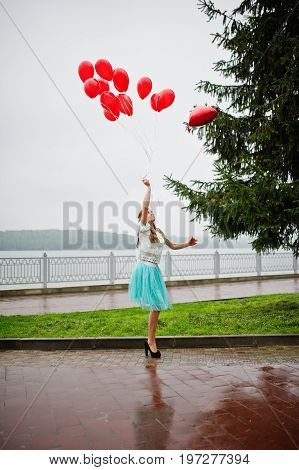 Portrait Of A Gorgeous Beautiful Bridesmaid In A Pretty Dress Holding Heart-shaped Red Balloons In T