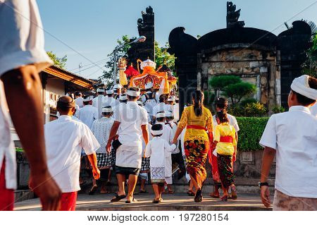 BALI INDONESIA - MARCH 07: Balinese people in traditional clothes take part in the ceremonial procession during Balinese New Year celebrations on March 07, 2016 in Bali, Indonesia