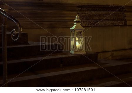 The Old Lantern With Candle On Stone Step Of Stairs