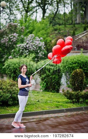 Portrait Of A Gorgeous Beautiful Bridesmaid In Casual Clothes Holding Heart-shaped Red Balloons In T