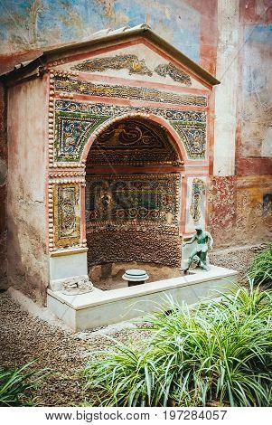 Decorated fountain in Casa della Fontana Piccola, ancient roman town of Pompeii, destroyed by vesuvius eruption in 79 BC