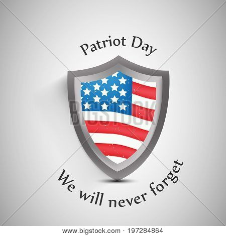 illustration of shield in USA flag background with Patriot Day We will never Forget text on the occasion of Patriot Day