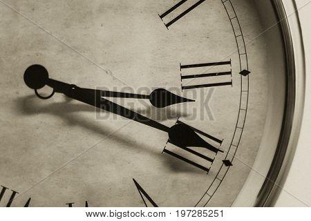 Closeup Antique Old Style Clock Time Roman Hour Number Vintage Color Tone With Film Graineffect.