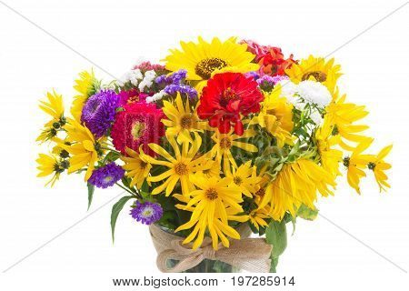 Bright fall flowers bouquet in vase close up isolated on white background