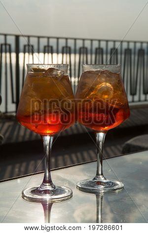 Waiter Prepared The Aperol Sprits Summer Cocktail With Aperol, Prosecco, Ice Cubes And Orange In Win