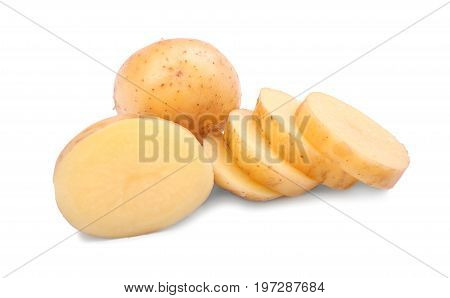 Uncooked potato tubers isolated over the white background. Fresh and delicious potatoes chopped in round pieces. A whole potato and a half of a tuber. Nutritious rustic vegetables.