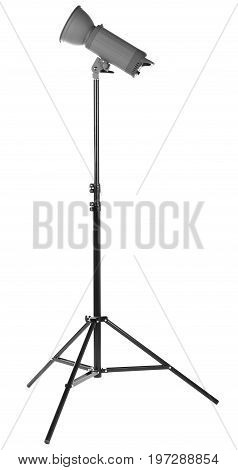 Studio lighting on a tripod stand, isolated on a white background. Professional photo equipment. Modern powerful photographic flash. Studio spotlight.