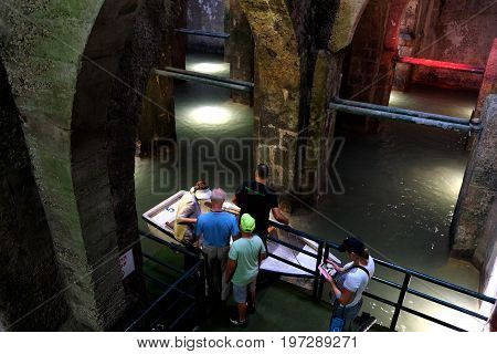 RAMLA ISRAEL - JULY 22 2017: Boating in the underground Arched Pool - an ancient reservoir for drinking water 8th century AD