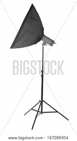 A long and modern saturated black softbox, isolated on a white background. Photographic lighting equipment. Stripbox on a metal tripod. Photography, shooting, technique concept.