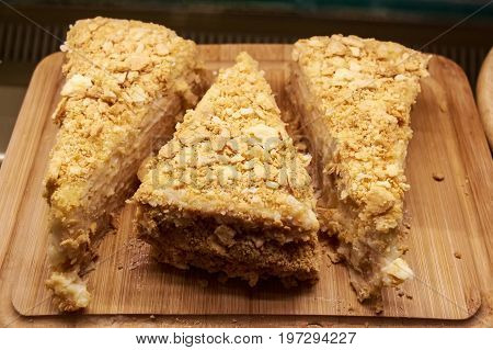 Closeup of delicious homemade puff cake called Napoleon on wooden board