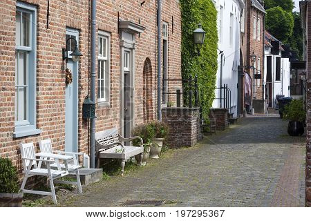 Old historical street with benches in Buren in the Netherlands
