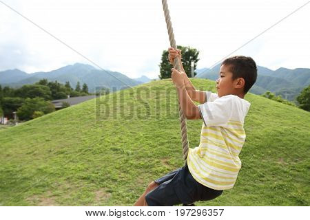 Japanese Boy Playing With Flying Fox (second Grade At Elementary School)