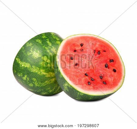 A round half  of a summer watermelon isolated on a white background. Watermelon is cut showing a hard, green rind,  sweet watery reddish flesh and black tiny seeds. The big berry is full of vitamins.
