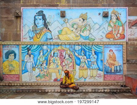 Holy Man Sitting On Ghat In Varanasi, India