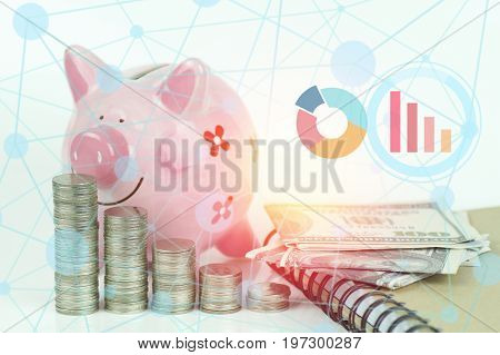 stacked of coins pink piggy bank aon white background with business connection graph concept in growth save and investment in business