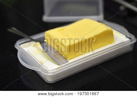 Butter Cube On The Black Table
