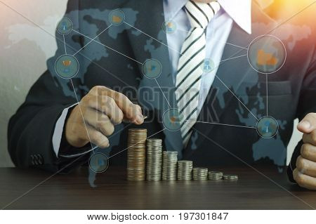 businesman put money pile of coins concept in growth save and investment in business