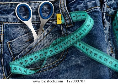 Metal Scissors In Jeans Pocket With Measure Tape