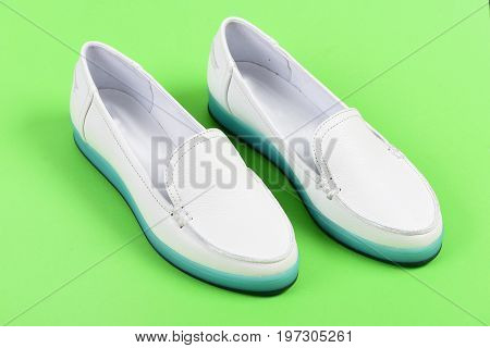 Moccasins For Women In White Color. Pair Of Female Shoes