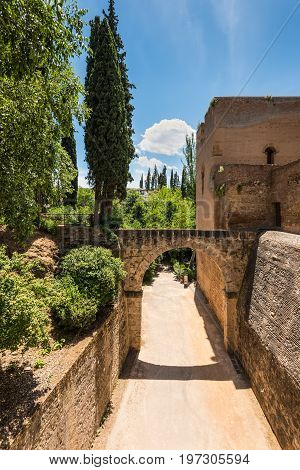 Granada Spain - May 19 2014: The bridge over the horse-drawn road in the Alhambra Palace Granada Andalusia Spain.