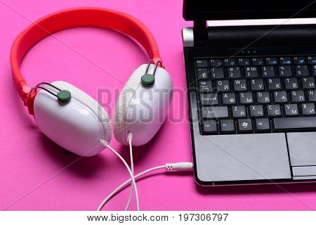 Sound Recording Idea. Earphones Made Of Plastic With Laptop