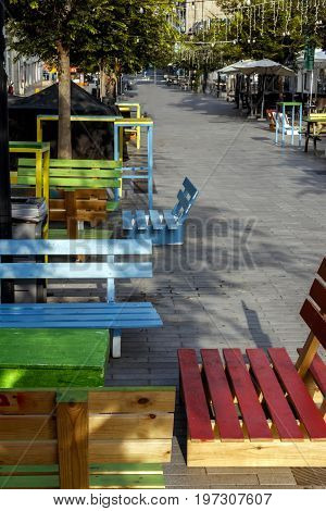 Multi-colored benches on the pedestrian zone no people