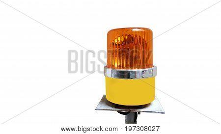 Orange rotating beacon on white reflective background.
